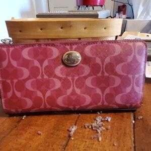 Coach red and pink accordion wallet.